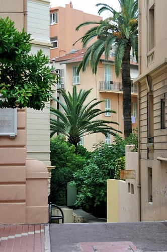 Monaco - Berény's special courtyard as seen from Rue Grimaldi ... the yellow building used to be peach colored ... and before that could have been pink or red